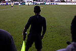 Marine 1 Hyde United 0, 12/12/2020. Marine Travel Arena, FA Trophy First Round. The referee's assistant watching the first-half action as Marine play Hyde United (in white) in an FA Trophy first round tie at the Marine Travel Arena, formerly known as Rossett Park, in Crosby. Due to coronavirus regulations which had suspended league games, the Merseysiders' only fixtures were in cup competitions, including their forthcoming tie against Tottenham Hotspur in the FA Cup third round. Marine won the game by 1-0, watched by a permitted capacity of 400, with the visitors having two men sent off in the second half. Photo by Colin McPherson.