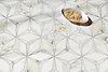 Cassiopeia, a stone waterjet mosaic, show in polished Calacatta Gold, is part of the Semplice® collection for New Ravenna.