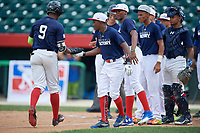Alberto Fabian (9) high fives Omar Florentino (3) after hitting a home run during the Dominican Prospect League Elite Underclass International Series, powered by Baseball Factory, on August 31, 2017 at Silver Cross Field in Joliet, Illinois.  (Mike Janes/Four Seam Images)