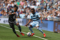 ST. PAUL, MN - AUGUST 21: Gadi Kinda #17 of Sporting Kansas City and Romain Metanire battle for the ball during a game between Sporting Kansas City and Minnesota United FC at Allianz Field on August 21, 2021 in St. Paul, Minnesota.