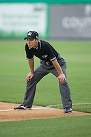 Umpire Kaz Endo handles the calls on the bases during the Appalachian League game between the Bluefield Blue Jays and the Burlington Royals at Burlington Athletic Park on July 1, 2015 in Burlington, North Carolina.  The Royals defeated the Blue Jays 5-4. (Brian Westerholt/Four Seam Images)