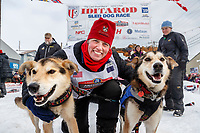 Aliy Zirkle poses with her lead dogs at the Nome finish line with her lead dogs Mismo and Dutch after placing 4th in the 2019 Iditarod on Wednesday March 13<br /> <br /> Photo by Jeff Schultz/  (C) 2019  ALL RIGHTS RESERVED