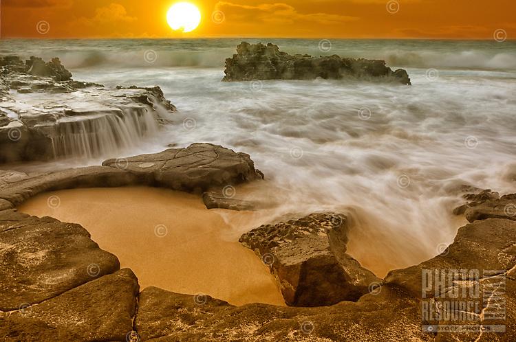 Sunrise at a Sandy Beach cove, East O'ahu.