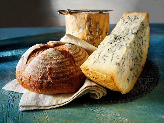 Traditional British blue Stilton cheese truckle photos