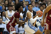 CHAPEL HILL, NC - FEBRUARY 1: Garrison Brooks #15 of the University of North Carolina backs in against CJ Felder #0 of Boston College during a game between Boston College and North Carolina at Dean E. Smith Center on February 1, 2020 in Chapel Hill, North Carolina.