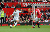 Pictured L-R: Jordi Amat of Swansea against Anderson of Manchester United. Saturday 16 August 2014<br /> Re: Premier League Manchester United v Swansea City FC at the Old Trafford, Manchester, UK.