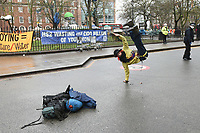 A protester performs a breakdance during a protest against the building of the HS2 railway line at Euston Square Gardens on 27th January 2021