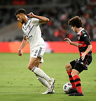 10th February 2021; Bankwest Stadium, Parramatta, New South Wales, Australia; A League Football, Western Sydney Wanderers versus Melbourne Victory; Rudy Gestede of Melbourne Victory back heels the ball past Mark Natta of Western Sydney Wanderers