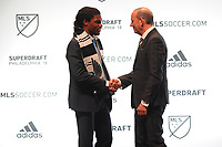 Philadelphia, PA - Thursday January 19, 2018: Carter Manley, Don Garber during the 2018 MLS SuperDraft at the Pennsylvania Convention Center.