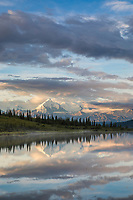 Early morning sunlight shines on Mt. Brooks and the Alaska Range by Wonder Lake, Denali National Park, Alaska.