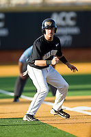 Pat Blair #11 of the Wake Forest Demon Deacons takes his lead off of third base against the Miami Hurricanes at Gene Hooks Field on March 19, 2011 in Winston-Salem, North Carolina.  Photo by Brian Westerholt / Four Seam Images
