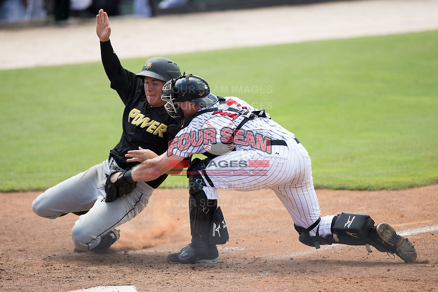 Ty Moore (22) of the West Virginia Power is tagged out at home plate by Kannapolis Intimidators catcher Casey Schroeder (17) at Kannapolis Intimidators Stadium on June 18, 2017 in Kannapolis, North Carolina.  The Intimidators defeated the Power 5-3 to win the South Atlantic League Northern Division first half title.  It is the first trip to the playoffs for the Intimidators since 2009.  (Brian Westerholt/Four Seam Images)