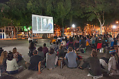 "A crowd watches an open-air public screening of the film ""Belo Monte, Announcement of War"" in Praça Tiradentes, Rio de Janeiro, Brazil. 23rd July 2012. Photo © Sue Cunningham/SCP"