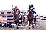 Verrazano, ridden by John Velazquez, outduels Normandy Invasion (red cap) and Vyjack (pink cap) to win the Wood Memorial Stakes on Wood Memorial Day at Aqueduct Race Track in Ozone Park, New York on April 6, 2013 (( Special transmission of horses in the Top 25 for points for the 2013 KentuckyDerby ))
