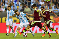 Foxborough, MA - Saturday June 18, 2016: Lionel Messi, Tomas Rincon during a Copa America Centenario quarterfinal match between Argentina (ARG) and Venezuela (VEN)  at Gillette Stadium.