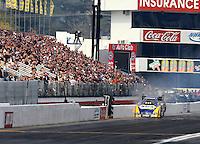 Feb 9, 2014; Pomona, CA, USA; NHRA funny car driver Ron Capps hits the wall during the Winternationals at Auto Club Raceway at Pomona. Mandatory Credit: Mark J. Rebilas-