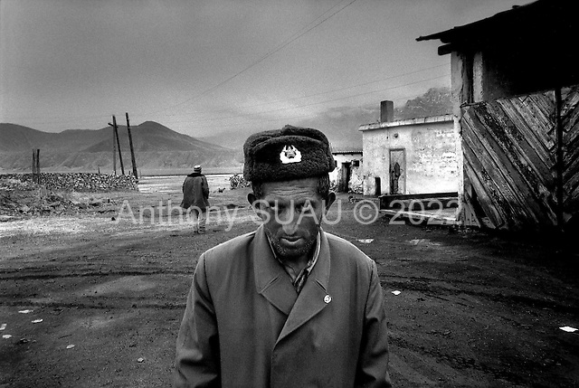 Horag-Osh Road, Tajikistan .1996.Truck drivers stop the night along the old silk road in Moragob located high in the Pamir mountains. Many of these trucks carry concelled amounts of opium destined for Western Europe..