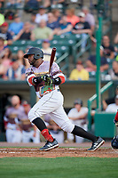Rochester Red Wings first baseman Kennys Vargas (30) hits a single during a game against the Lehigh Valley IronPigs on June 29, 2018 at Frontier Field in Rochester, New York.  Lehigh Valley defeated Rochester 2-1.  (Mike Janes/Four Seam Images)