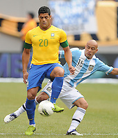 Brazil forward Hulk (20) shields the ball from Argentina defender Clemente Rodriguez (15) The Argentina National Team defeated Brazil 4-3 at MetLife Stadium, Saturday July 9 , 2012.