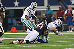 Houston Texans linebacker Delano Johnson (64) and Dallas Cowboys quarterback Alex Tanney (7) in action during the pre-season game between the Houston Texans and the Dallas Cowboys at the AT & T stadium in Arlington, Texas. Houston defeats Dallas 24 to 6.