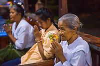 Thailand, Mae Hong Son. Wat Chong Klang Buddhist Monastery. Locals making offerings.