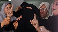 "A Palestinian mother of Hamas militant Mohammed al-Batniji during his funeral in Gaza August 8, 2007. Israeli troops killed two Palestinian gunmen during a gun battle in the southern Gaza Strip on Wednesday, residents, ambulance workers and army officials said. ""photo by Fady Adwan"""