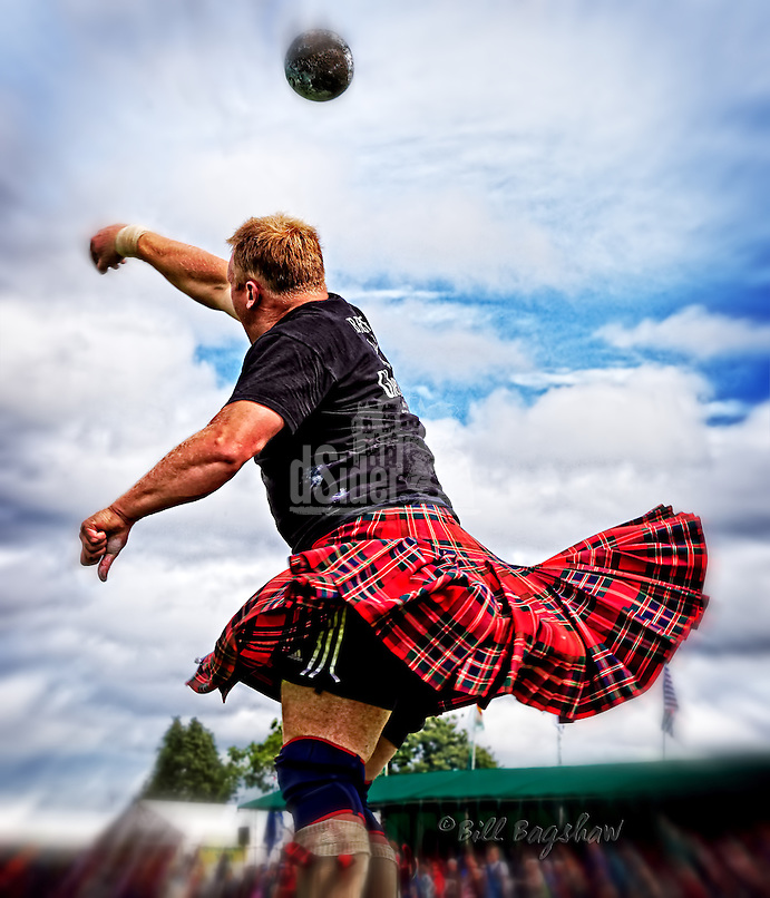 Swirling kilts as The Heavies put the stone at The Aboyne Highland Games,Royal Deeside,Scotland.<br /> www.dsider.co.uk