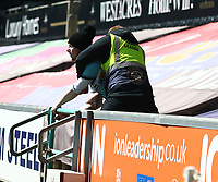 17th April 2021; Liberty Stadium, Swansea, Glamorgan, Wales; English Football League Championship Football, Swansea City versus Wycombe Wanderers; A Wycombe Wanderers fan manages to get into the ground during play but is stopped by a steward