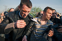 Moscow, Russia, 06/05/2012..A protestor bleeding from his head is rescued after being kicked on the ground by riot police at opposition demonstration against Russian Presidential election results on the eve of Vladimir Putins inauguration as President.