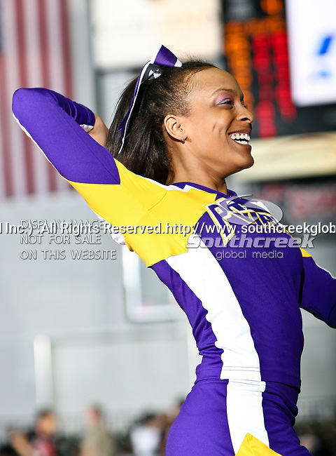 A Prairie View A&M Lady Panthers cheerleader in action during the SWAC Tournament Championship game between the Prairie View A&M Lady Panthers and the Southern University Jaguars at the Special Events Center in Garland, Texas. Prairie View defeats  Southern 48 to 44
