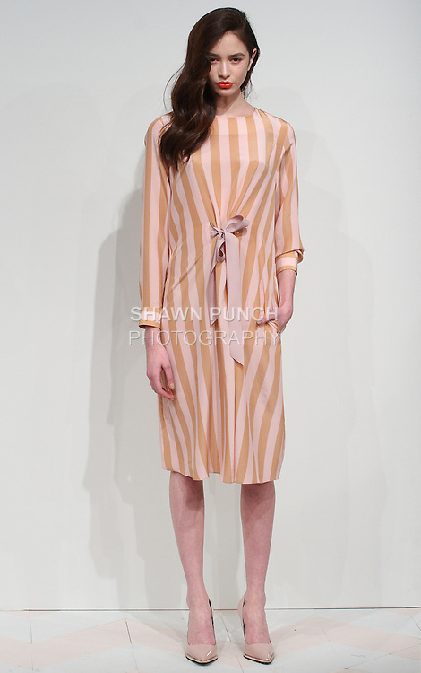 Model poses in an outfit from the Kaelen Fall Winter 2015 collection by Kaelen Haworth, during New York Fashion Week Fall 2015, on February 11, 2015.
