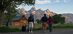 Photographers at the T.A. (Thomas Alma) Moulton Barn at sunrise. On Mormon Row, Antelope Flats, Grand Teton National Park, near Jackson Hole, Wyoming. USA. June 2013.