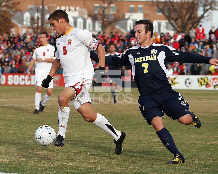 Doug Rodkey #5 of the University of Maryland turns the ball away from Chase Tennant #7 of the University of Michigan during an NCAA quarter-final match at Ludwig Field, University of Maryland, College Park, Maryland on December 4 2010.Michigan won 3-2 AET.
