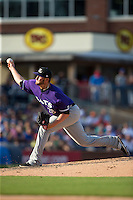 Louisville Bats relief pitcher Josh Smith (28) delivers a pitch to the plate against the Durham Bulls at Durham Bulls Athletic Park on August 9, 2015 in Durham, North Carolina.  The Bulls defeated the Bats 9-0.  (Brian Westerholt/Four Seam Images)