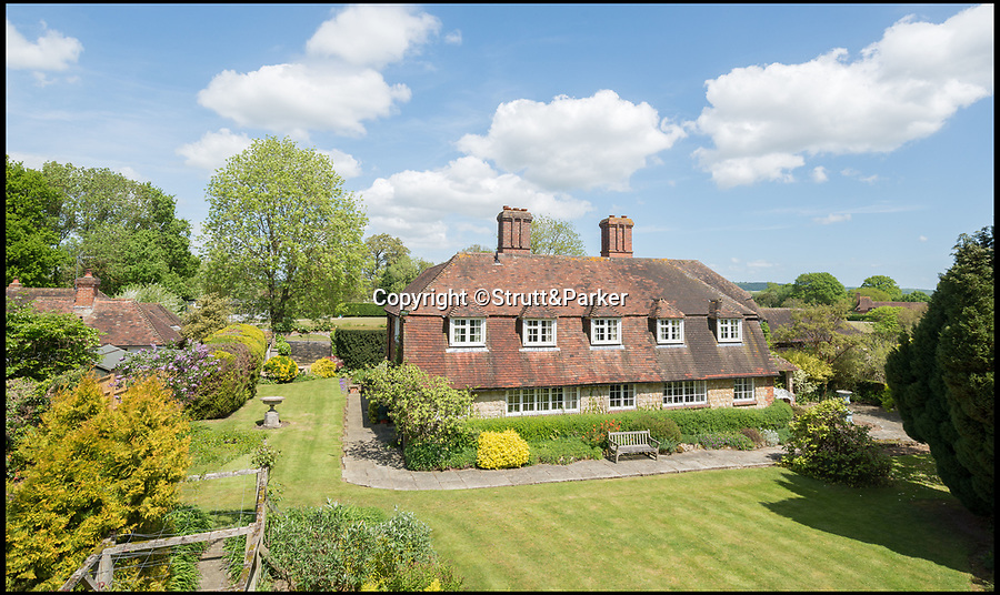 BNPS.co.uk (01202 558833)Pic: Strutt&Parker/BNPS<br /> <br /> Perfick!<br /> <br /> The Darling Buds of May fans can now get their hands on the house that inspired the hit TV show - on the market for the first time in 90 years.<br /> <br /> Author HE Bates, who wrote the books that inspired the ITV series about Pop Larkin and his family, lived at The Granary in the Kent village of Little Chart for more than 40 years.<br /> <br /> After his death, his son Richard Bates was executive producer for the TV adaptation and used the green outside this house to film many of the scenes with Catherine Zeta Jones, David Jason, Pam Ferris and the rest of the cast.<br /> <br /> The house is now on the market with Strutt & Parker for £1.1m.