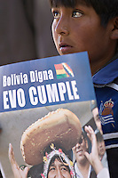 Chuquisaca, Bolivia<br /> A picture dated August 5, 2007 shows a young boy holding a sign with the image of Bolivian President Evo Morales, who was attending a ceremony in the city of Sucre.