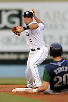 Asheville Tourists second baseman Taylor Featherston #2 completes a double play during a game against the Lexington Legends at McCormick Field on May 7, 2012 in Asheville, North Carolina . The Tourists defeated the Legends 4-3. (Tony Farlow/Four Seam Images).