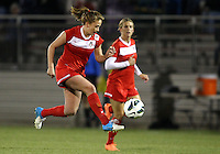 BOYDS, MARYLAND - April 06, 2013:  Caroline Miller (10) of The Washington Spirit controls a bouncing ball against the University of Virginia women's soccer team in a NWSL (National Women's Soccer League) pre season exhibition game at Maryland Soccerplex in Boyds, Maryland on April 06. Virginia won 6-3.