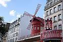 Paris, France. 09.05.2015. External view of the Moulin Rouge, Pigalle, Paris, France. Photograph © Jane Hobson