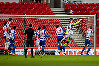 6th February 2021; Bet365 Stadium, Stoke, Staffordshire, England; English Football League Championship Football, Stoke City versus Reading; Steven Fletcher of Stoke City challenges for the header with Reading keeper Cabral Barbosa