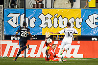 Philadelphia Union goalkeeper Zac MacMath (18) makes a save on a shot by Landon Donovan (10) of the Los Angeles Galaxy. The Los Angeles Galaxy defeated the Philadelphia Union 4-1 during a Major League Soccer (MLS) match at PPL Park in Chester, PA, on May 15, 2013.