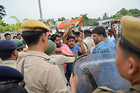 Pictured: Congress activists struggle against riot police officers.<br /> Re: Activists of the Congress political party clash with police in protest against price rises in oil, gas and other daily commmodities by BJP government in Agartala, in the Tripura area of India. Monday 10 September 2018