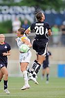 LA. Sol defender Brittany Bock (11) heads the ball against Washington Freedom forward Abby Wambach (20).  The LA Sol defeated the Washington Freedom 1-0 at the Maryland Soccerplex, Sunday July 5, 2009.