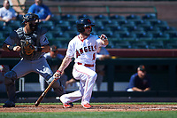 Scottsdale Scorpions center fielder Troy Montgomery (4), of the Los Angeles Angels organization, at bat in front of catcher Brett Sullivan (13) during an Arizona Fall League game against the Surprise Saguaros on October 27, 2017 at Scottsdale Stadium in Scottsdale, Arizona. The Scorpions defeated the Saguaros 6-5. (Zachary Lucy/Four Seam Images)