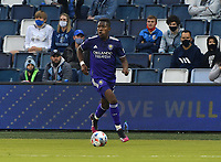 KANSAS CITY, KS - APRIL 23: Andres Perea #21 of Orlando City SC drives his team's attack from the left side during a game between Orlando City SC and Sporting Kansas City at Children's Mercy Park on April 23, 2021 in Kansas City, Kansas.