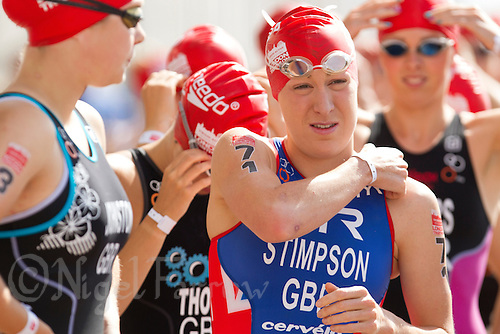 28 JUL 2013 - LONDON, GBR - Jodie Stimpson prepares for the start of the Elite Women's race during the 2013 Virgin Active London Triathlon at Excel, Royal Victoria Dock in London, Great Britain (PHOTO COPYRIGHT © 2013 NIGEL FARROW, ALL RIGHTS RESERVED)