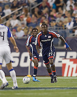 New England Revolution midfielder Shalrie Joseph (21), prior to red card ejection, looks downfield. The Kansas City Wizards  defeated New England Revolution, 4-2, at Gillette Stadium on September 5, 2009.