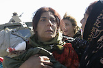 AR RUTBAH, Iraq- A mother holds her dead daughter after an explosion. Two of her daughters were killed and her son is in the hospital. The Marines of Regimental Combat Team 2 conduct counter-insurgency operations with Iraqi Security Forces to isolate and neutralize anti-Iraqi forces, to support the continued development of Iraqi Security Forces, and to support Iraqi reconstruction and democratic elections in order to create a secure environment that enables Iraqi self-reliance and self-governance. (Official USMC photo by Lance Cpl. Shane S. Keller)