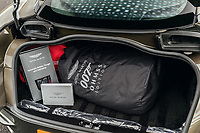 BNPS.co.uk (01202 558833)<br /> Pic: SilverstoneAuctions/BNPS<br /> <br /> The car comes with its original boot full of Bond related goodies.<br /> <br /> Stunning Aston Martin 'James Bond' supercar with only 45 miles on the clock - yours for £300,000.<br /> <br /> A limited edition Aston Martin that was built to mark the 50th anniversary of one of the most popular James Bond movies has emerged for sale for around £300,000.<br /> <br /> The DBS Superleggera was one of just 50 created last year to commemorate five decades since the release of On Her Majesty's Secret Service.<br /> <br /> The movie, which came out in 1969, was the first in the franchise not to feature Sean Connery and instead starred George Lazenby as 007.