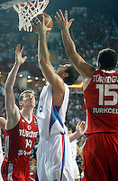 Nenad KRSTIC (Serbia)   passes Hidayet TURKOGLU (Turkey) and Omer ASIK (Turkey) during the semi-final World championship basketball match against Turkey in Istanbul, Serbia-Turkey, Turkey on Saturday, Sep. 11, 2010. (Novak Djurovic/Starsportphoto.com) .